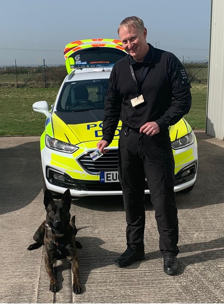Police dogs presented with collar numbers and warrant cards